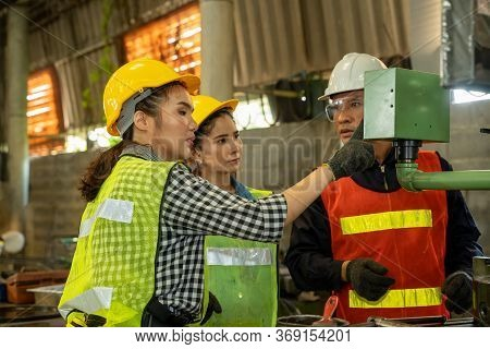 Factory Worker And Engineer As Team Working In A Factory.