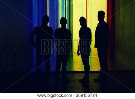 Silhouette Of Four People, Unrecognised Person In Full Length