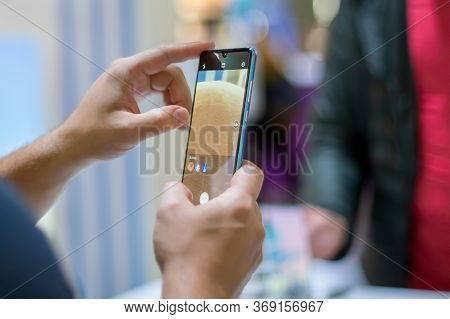 Moscow, Russia - October 04, 2019: A Caucasian Mans Hands Hold New Flagship Smartphone Huawei P30 Pr