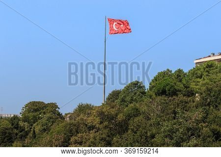 Anadolu Kavagi, Turkey  - September 12, 2017: This Is The Flag Of Turkey Fluttering In The Wind On A