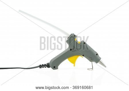 Small Hot Melt Glue Gun With Sticking Glue Stick Isolated On A White Background