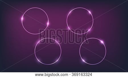 Set Of Four Neon Circle Frames With Shining Effects On Dark Background. Empty Glowing Techno Backdro