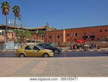 Marrakesh, Morocco - 12 October, 2019: Urban Transport In Morocco. Traditional Beige Taxi And Horse