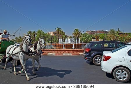 Marrakesh, Morocco - 12 October, 2019: Blurred Motion Of A Pair Of White Horses Harnessed To A Carri