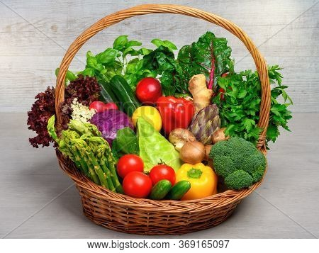 Vintage Basket Filled With An Arrangement Of Mixed Colorful Vegetables On Light Background, Looking