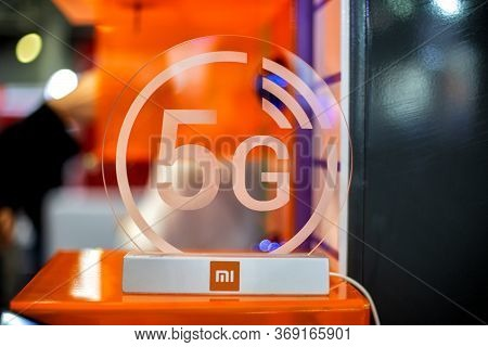 Moscow, Russia - October 04, 2019: 5g White Icon Xiaomi On Transparent Plastics. Orange Background I
