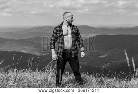 Muscular Male. Cowboy In Hat Outdoor. Sexy Macho Man In Checkered Shirt. Man On Mountain Landscape.