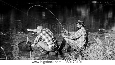 Black Market Caviar. Poachers Fishing. Trap For Fish. Men Sit At Riverside With Fishing Equipment. I