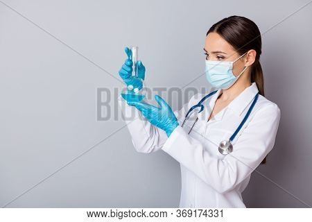Photo Of Serious Virologist Doc Lady Experienced Professional Hold Glass Test Flask Tube Examining V