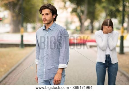 Break Up. Indifferent Boyfriend Leaving Crying Girlfriend Quitting Relationship Standing Outdoors. S