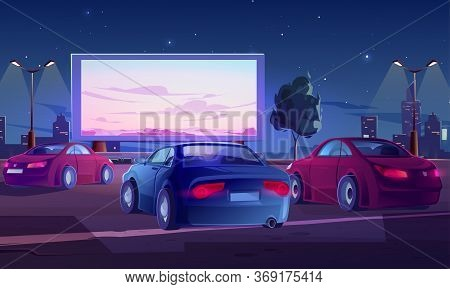 Car Street Cinema. Drive-in Theater With Automobiles Stand In Open Air Parking At Night. Large Outdo