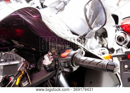 Right Side Of Motorcycle Steering Wheel Close-up. The Handle Of The Gas Sportbike, With Windshield,