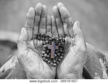 Rosary In Hand. Senior Woman Holding Rosary With Jesus Christ Holy Cross Crucifix In Hands In Black