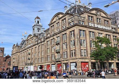 Amsterdam, Netherlands - July 9, 2017: People Walk By De Bijenkorf Flagship Department Store In Amst