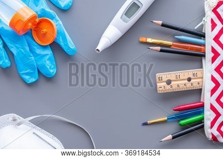 Back To School Flat Lay Arrangement With Copy Space. School Supplies And Medical Equipment Needed To