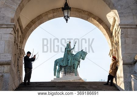 Budapest, Hungary - Feb 9, 2020: Tourist Take Photo On Stair Of Fisherman Bastion With Equestrian St