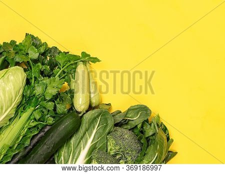 Fresh Organic Vegetables On Yellow Table From Above