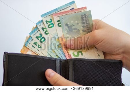 Pay In Euros. Get Euros From Your Wallet. Euro Bills On A White Background With A Wallet