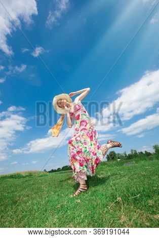 Woman dancing in the field