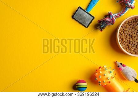 Pet Care And Training Concept. Flat Lay Composition With Toys For Cat And Dog And Bowl With Dry Food