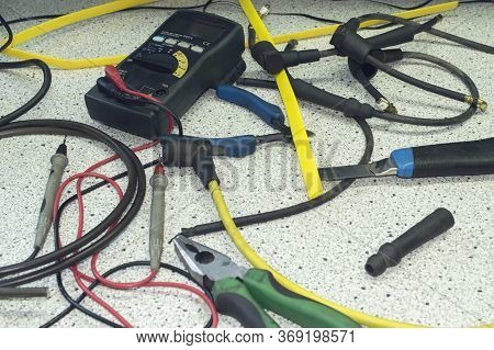 The Electrician's Equipment And The Tips Of The High Voltage Wires Of The Gasoline Engine Ignition S