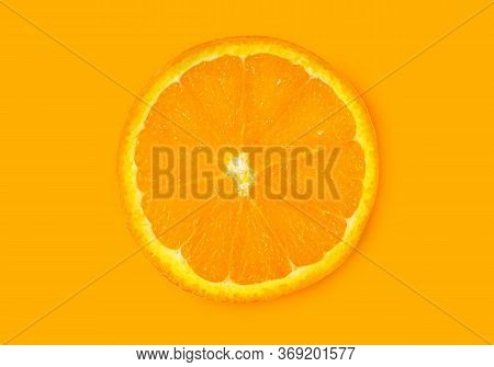 Orange Fruit. Round Orange Slice Isolate On Orange Background. Top View, Flat Lay.