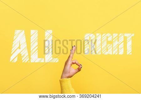 Hand Ok Sign With All Right Inscription Over Trendy Yellow Background
