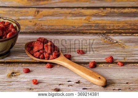 Dried Fruits, Strawberry In Wooden Ladle On Vintage Wooden Backgrounds. Selective Focus