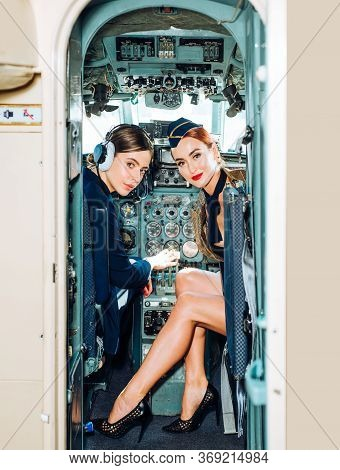 Pilot And Stewardess. Wishes A Successful Flight. Avia Company Persons Crew Pilots Stewardess Airpla