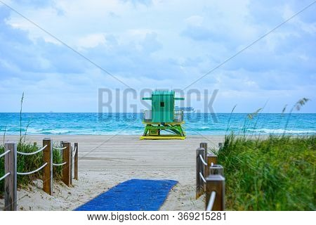 Miami Beach With Lifeguard Tower And Coastline With Colorful Cloud And Blue Sky. South Beach. Panora