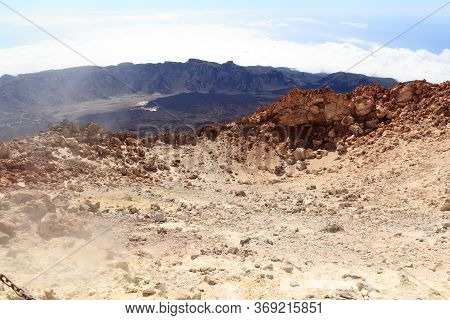 Mount Teide Volcanic Crater With Fumarole Emitting Sulfur Dioxide And Mountain Panorama On Canary Is