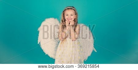 Valentines Day. Angels Little Hands Crossed For You. Mischievous Little Angel Girl Standing With You