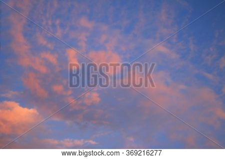 Bright Blue Sky With Pink Clouds Background.  Dramatic Sky. Colorful Sunset Sunrise Sky. Skyscape An