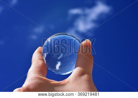 Reflections Of The Clouds In A Cloudy Day In A Crystal Ball, Environment Concept