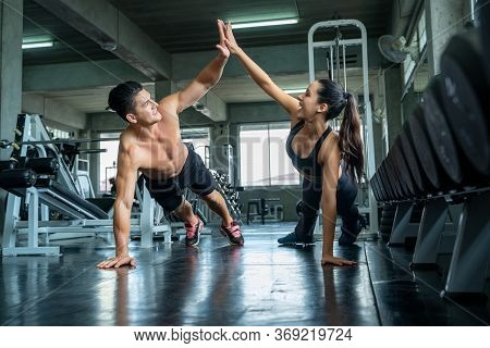Fitness Man And Woman Doing Push Ups After The Training Session,fit Couple High Five After Workout I