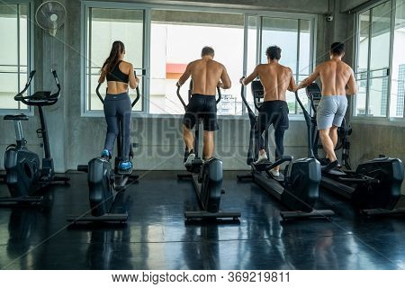 Group Of Young People Running On Treadmills In Modern Gym,fitness Exercise And Healthy Concept.