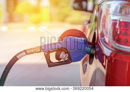 Car Refueling On The Petrol Station With Pumping Gasoline Fuel In Car, Diesel Or Gasoline Being Pump