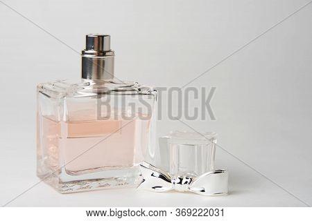 Pink Womens Perfume Bottle In A Rectangular Glass Bottle On A White Background