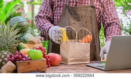 Farmer Sell Fresh Fruit Online. Online Shopping And Home Delivery Concept. New Normal Life And Busin