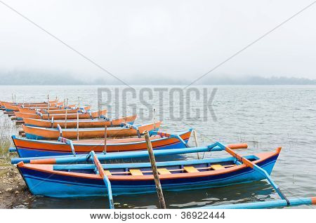 boats and lot of foggy on a lake