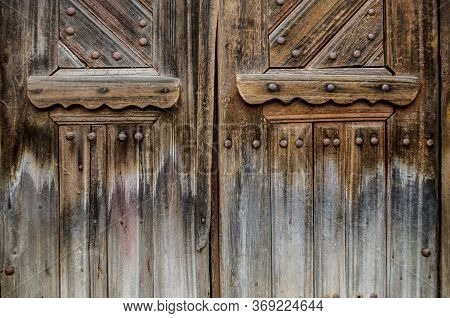Old Wooden Door In The Ukrainian House. Rustic Style Photo.