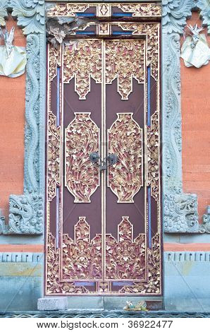 wooden door of country house with carved ornament Bali Indonesia