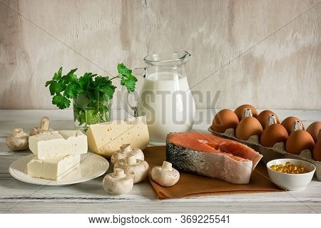 A Set Of Food With Vitamin D. Ingredients High In Vitamin D: Milk, Butter, Salmon, Cheese, Mushrooms