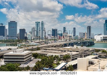 Downtown Of Miami Skyline Viewed From Dodge Island With Cruise Terminal At Biscayne Bay In Miami, Fl