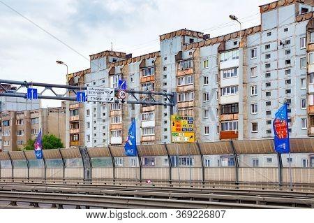 Kaliningrad, Russia - June 13, 2018: Typical Shabby Residential Buildings Near The Modern Bridge Fro