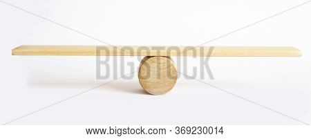 Balance Concept, Board On Wooden Top Hat Like Balance Isolated On White Background.