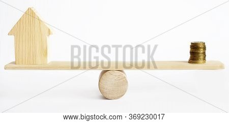 Balance Concept, Board On Wooden Top Hat Like Balance Isolated On White Background. Model House And