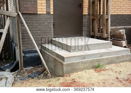 Incomplete Front Porch Steps, Stairs To The Entrance Door Built From Cement Of A Brick Unfinished Ho