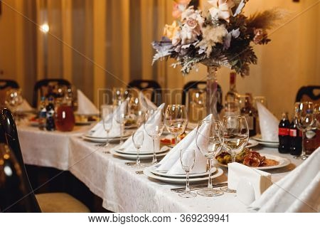 The Table Setting Empty Wine Glasses On White Tablecloth