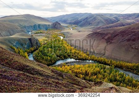 Beautiful Sun Valley And The Open River Kyzyltan Between The Mountains With Lush Clouds. Autumn Fore